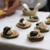 Acadian caviar on buckwheat blini at Evergreen Brickworks Toronto (Photo Credit: Ye Jin Bae)